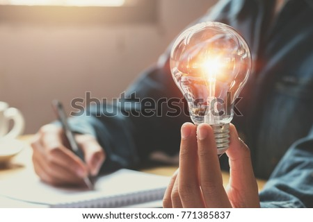 new idea and creative concept for business woman hand holding light bulb Foto d'archivio ©
