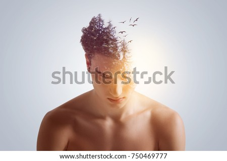 New idea birth. Good-looking open-headed  focused guy looking down with lowering shoulders  on the grey background