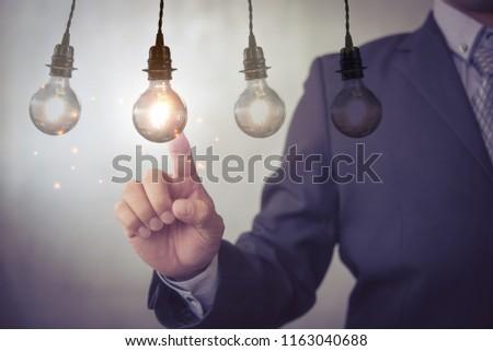 new idea creative idea.Concept of idea and innovation.Hand touch Light blub #1163040688