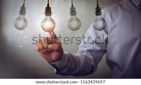 new idea creative idea.Concept of idea and innovation.Hand touch Light blub #1163439697
