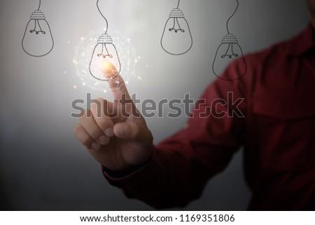 new idea creative idea.Concept of idea and innovation.Hand touch Light blub #1169351806