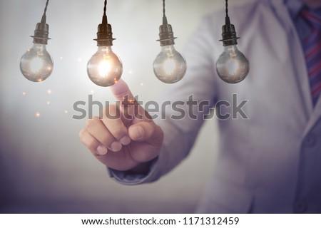 new idea creative idea.Concept of idea and innovation.Hand touch Light blub #1171312459