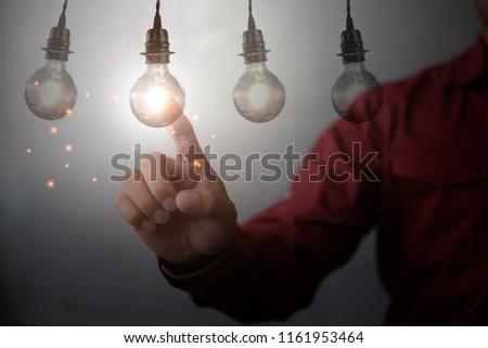 new idea creative idea.Concept of idea and innovation.Hand touch Light bulb #1161953464
