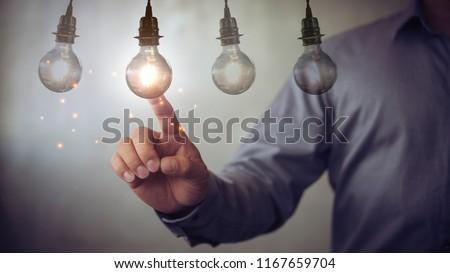 new idea creative idea.Concept of idea and innovation.Hand touch Light bulb #1167659704