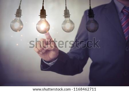 new idea creative idea.Concept of idea and innovation.Hand touch Light bulb #1168462711