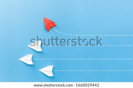 New ideas creativity and different innovative solution. Business concept. A group of paper airplanes, one plane is flying in the other direction, different way. ストックフォト ©