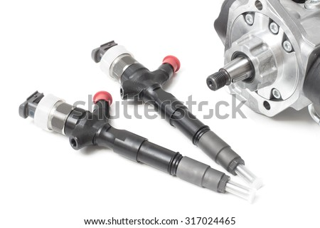new injectors for diesel fuel with the fuel pump are high davteniya and fuel strap on a white background #317024465