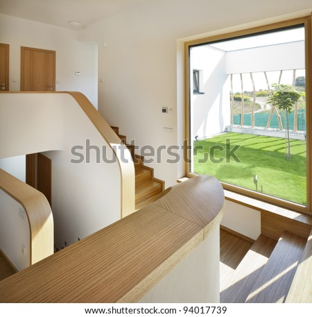 New interesting interior with stairs and a garden view