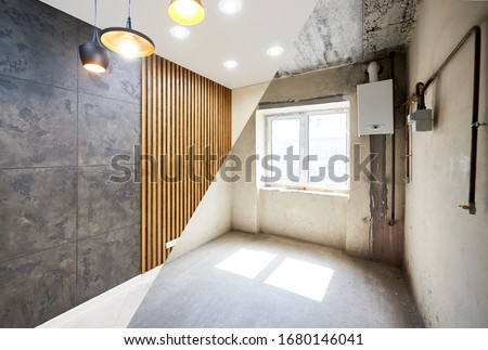 New kitchen before renovation works and after, creative combination of black wallpaper and wood planks on wall, shiny tiles on the floor and different modern chandeliers hanging from ceiling Photo stock ©