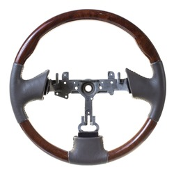 New leather steering wheel with wooden insets on white background