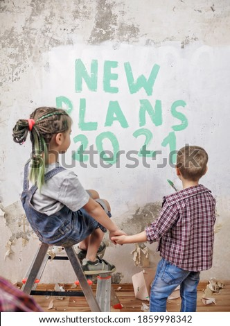 New life begins with home improvement. Kids repairing room, unhanging wallpaper and planning new year on wall with color paint. Maintenance and repair, new goal after lockdown. Selective focus on wall Stockfoto ©
