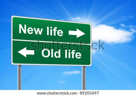 New life old life road sign on background clouds and sunburst.