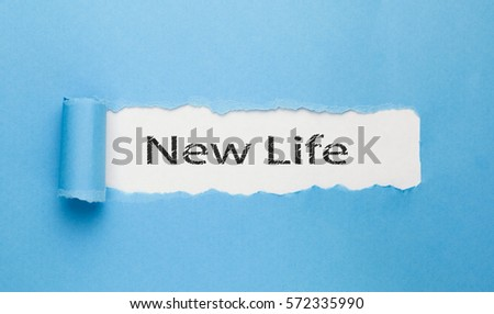 new life text  written on paper on blue background #572335990