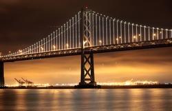New lights illuminate the Bay Bridge connecting San Francisco and Oakland over San Francisco Bay in California.