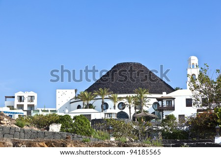 new living area in Playa Blanca with a hotel like a volcano