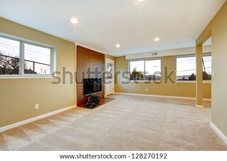 Delightful New Living Room With Fireplace, Beige Carpet And Many Windows.