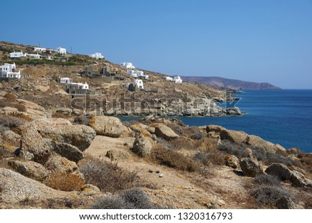 New luxurious buildings for tourists at Lia beach in Mykonos, Greece which show the turbulent tourist development of the island