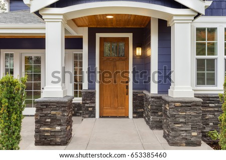 Shutterstock New Luxury Home Exterior Detail: New House Front Door and Covered Patio