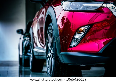 New luxury SUV compact car parked in modern showroom for sale. Car dealership office. Car retail shop. Electric car technology and business concept