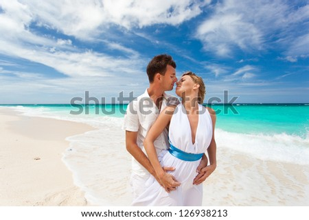 New married couple on white beach