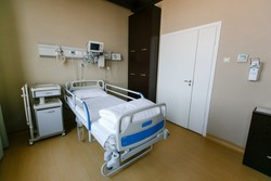 New medical center. Clean and empty room with a new bed in the new medical center.
