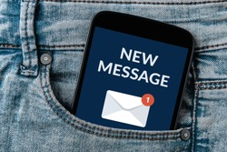 New message notification concept on smartphone screen in jeans pocket. All screen content is designed by me.