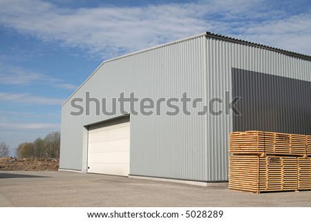 New metal warehouse for lumber on factory territory