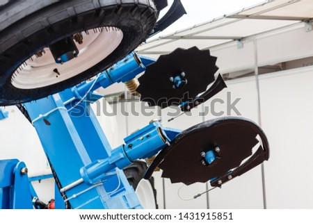 New, modern agricultural machinery. Stubble cultivator close-up. Agricultural machinery in agricultural fair. Parts and components of agricultural machines.