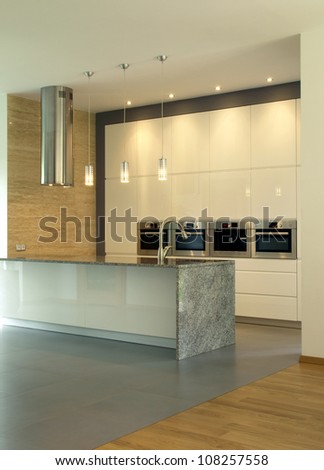 New, modern and bright kitchen with lighting - stock photo