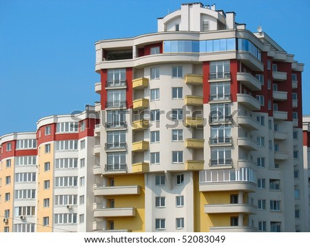 New modern apartments house over blue sky background - stock photo