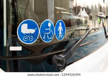 New modern bus on LPG. International Symbol of Access - Wheelchair Symbol (handicapped, physically challenged and disabled), Baby Stroller Symbol and Elderly (Old) People Symbol on the windshield.