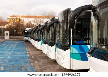 New modern busses on LPG. International Symbol of Access - Wheelchair Symbol (handicapped, physically challenged and disabled) in front of the busses.