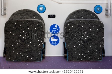 New modern busses on LPG. International Symbol of Access - Wheelchair Symbol (handicapped, physically challenged and disabled), Baby Stroller Symbol near the seats.
