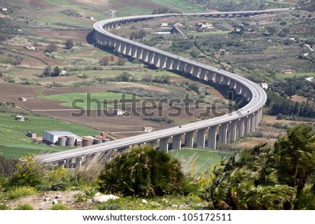 new modern highway winding among green valley, Segesta village, Sicily, Italy