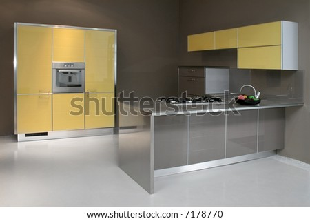 New modern kitchen in yellow with metal