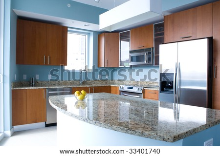 New Modern Kitchen Interior With Island In A Condo Apartment ...