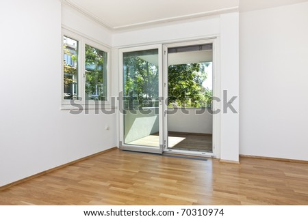 new modern living room with open door to the balcony in green area