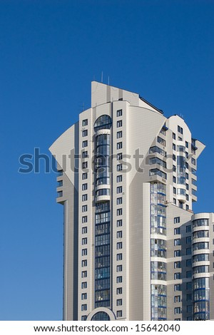 New modern multistory building on blue sky background