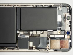 New modern smart phone internal isolated, chip, motherboard, processor, battery, cpu, frontal camera and details. Component repair. Cellphone chipset inside.