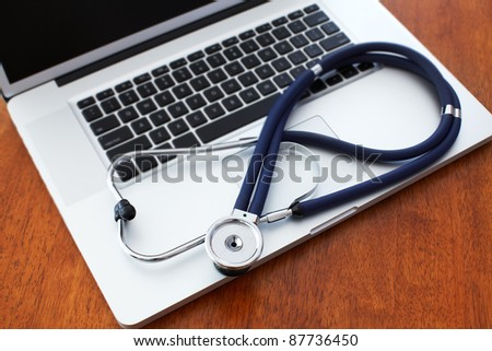 New modern tablet computer with stethoscope. Technology. Information.
