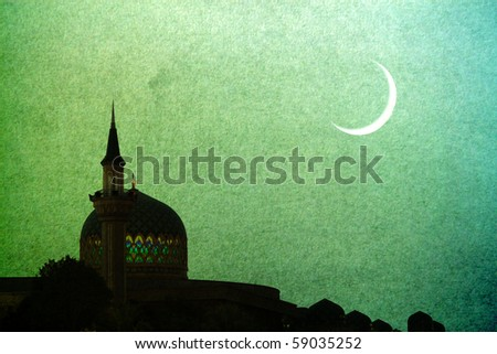 New moon on ramadan with a mosque.