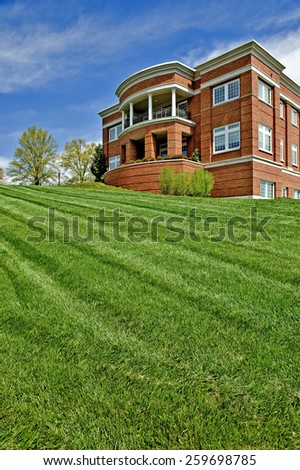 New Mowed Lawn In Front Of Unidentified City Building