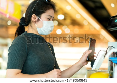 new normal after covid epidemic asian female payment progress buy scaning app by smarthine cashless and touchless new lifestyle shopping in department store cashier counter