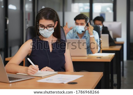 new normal business practise of business people work in office wearing face mask to protect coronavirus covid-19 infection. business new normal to protect coronavirus covid-19 to work in office