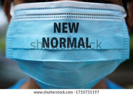 NEW NORMAL word on 3 ply face surgical mask. Life after pandemic concept. Stock fotó ©