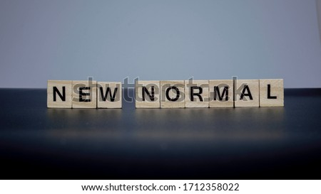 NEW NORMAL word on wooden alphabet cube. New normal after covid-19 pandemic with social distancing, good hygiene. Stock fotó ©
