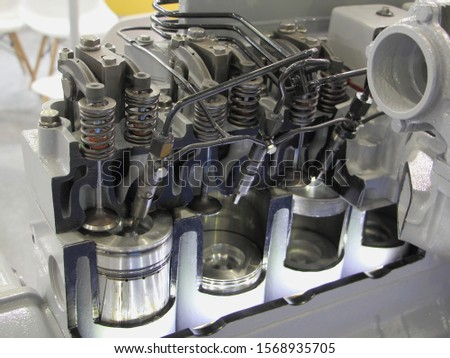 New OHV four stroke engine model in cut close up, car fuel direct injector motor - pistons, valves, injectors