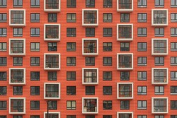 New orange building facade in housing complex