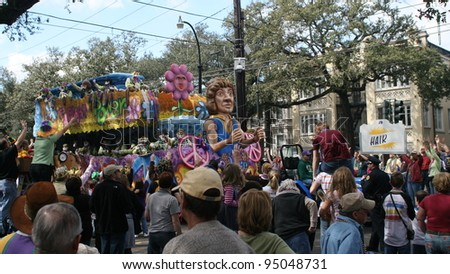NEW ORLEANS - FEBRUARY 2: People on the float threw doubloons and beads to the crowd in Mardi Gras parade. February 2, 2008 in New Orleans, Louisiana.