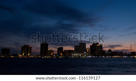 New Orleans, LA city skyline at sunset